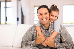 Little daughter military father. Beautiful little daughter and military father at home stock photos