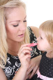 Little daughter and mother with pink lipstick Stock Photo