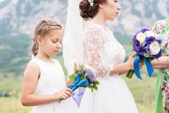 Little daughter next to her mother who is getting married Stock Photo