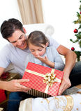Little daughter opening a Christmas present Stock Photography