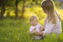 Little daughter who is making funny faces on a meadow Stock Photo
