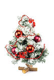Little decorated christmas tree with baubles and snow Royalty Free Stock Photo
