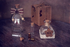 Little decorative bottles on the wooden table. Still life with bottles. Royalty Free Stock Photography