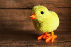 Little decorative chicken on wooden background Royalty Free Stock Images
