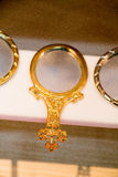 Little decorative gold color hand mirror Stock Image