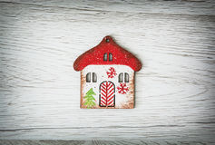 Little decorative house on the wooden background Stock Image