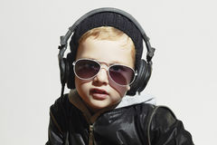 Little deejay. funny boy in sunglasses and headphones Royalty Free Stock Photo