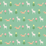 Little deer with fox and spring flowers seamless pattern on green background. Royalty Free Stock Image