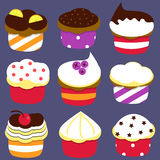 Little delicious cupcakes  set. Set of nine  cute cupcakes Royalty Free Stock Image