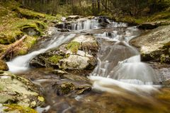 Little delta in a long exposure waterfall Mojonavalle Canencia Madrid stock photos