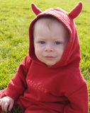 Little Devil. Eight month old child in a devil costume Stock Photos