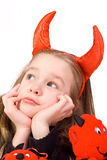 Little devil. Young Child Dressed in a Devil Costume on White Background Stock Photos