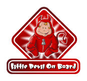 Little Devil on Board Sign Royalty Free Stock Photography