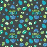Little Dino Lettering with Colorful Spotted Dinosaur Eggs on Dark Background Seamless Pattern Vector Illustration stock photos