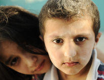 Little dirty brother and sister, poverty Royalty Free Stock Image