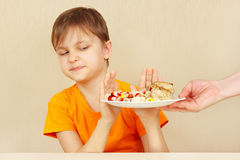 Little disaffected boy refuses to eat pasta with cutlet Royalty Free Stock Image