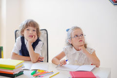 Little disciples on the lesson at school. Royalty Free Stock Photos