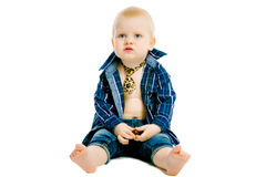 Little dissatisfied boy in a plaid shirt Royalty Free Stock Photos