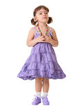 Little dissatisfied girl on a white background. A little dissatisfied girl in a lilac dress on a white background stock photos
