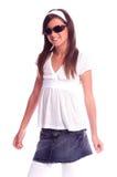 Little Diva. Girlin white leggings, denim skirt, polkadot top and sunglasses Stock Photo