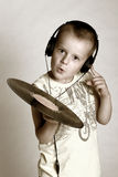Little dj. Child in headphones with grame playing dj Royalty Free Stock Image
