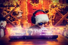 Little dj behind console royalty free stock photos