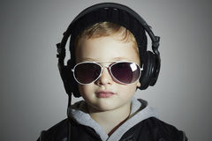 Little DJ. funny boy in sunglasses and headphones.child listening music in headphones. deejay Stock Photography