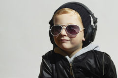 Little DJ. funny boy in sunglasses and headphones Stock Photography