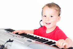 Little DJ on the keyboard Stock Images