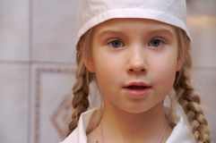 The little doctor. The girl in the fancy dress of doctor Stock Photos