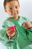 Little  doctor  boy giving syrup Stock Photo