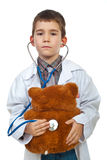 Little doctor examine bear toy Stock Images