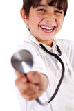 Little doctor showing his Stethoscope Royalty Free Stock Photo