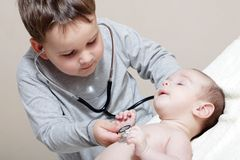 Little doctor with stethoscope Royalty Free Stock Photo
