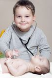 Little doctor with stethoscope Royalty Free Stock Image