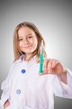 Little doctor with syringe Royalty Free Stock Photography