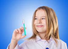 Little doctor with syringe Royalty Free Stock Photo