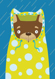 Little dog in a yellow raincoat in the rain. Little dog in a raincoat in the rain Stock Photos