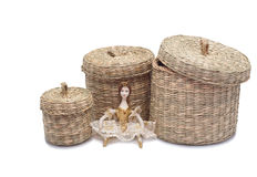 Little doll among baskets Royalty Free Stock Photos