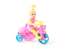 Little doll and bicycle Stock Photos