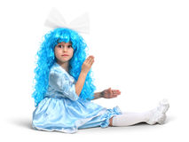 Little doll girl with blue hair Stock Photo