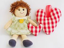 Little doll and hearts Stock Photos