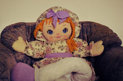 Little doll. My little doll sitting down Stock Image
