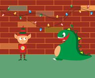 Little dragon and elf. Little dragon funny attacking an elf to get all the presents Stock Photos