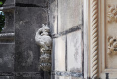 Little dragon statue on the wall, Quinta da Regaleira Palace in Sintra, Portugal. Detail in the park - little dragon statue on the wall, Quinta da Regaleira Stock Photo
