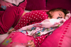 Little dream. 2 years old little girl sleep in home bed Royalty Free Stock Image