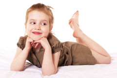 Little dreamer. Little girl lying on bed and dreaming Royalty Free Stock Photo