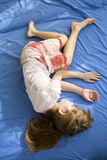 Little dreaming girl lying on the bed. Royalty Free Stock Images