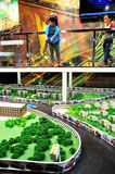 Little Drivers. Kids are controlling remote toy cars in a mini city virtual road to learn traffic rules.Taken at the Chana Auto Exhibition in Chongqing Science Royalty Free Stock Photo