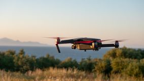 Drone hovering at coast. Little drone flying at the coast of Zakynthos, Greece stock photos